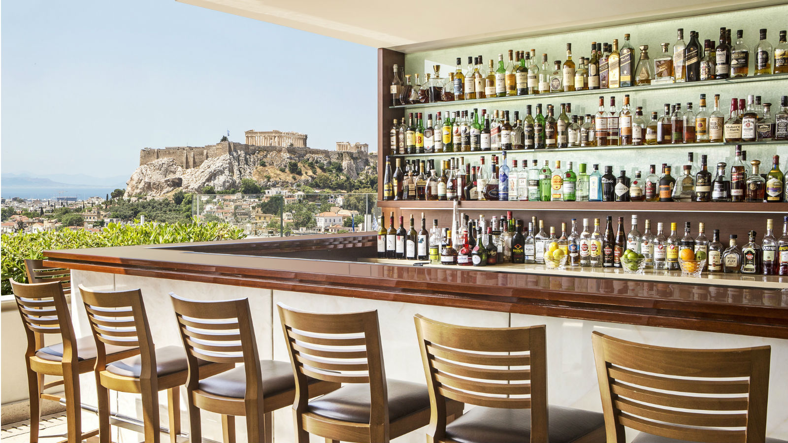 Linger over a drink or signature cocktail at the GB Roof Garden Bar, enjoying amazing views to the Acropolis - Hotel Grande Bretagne, Athens