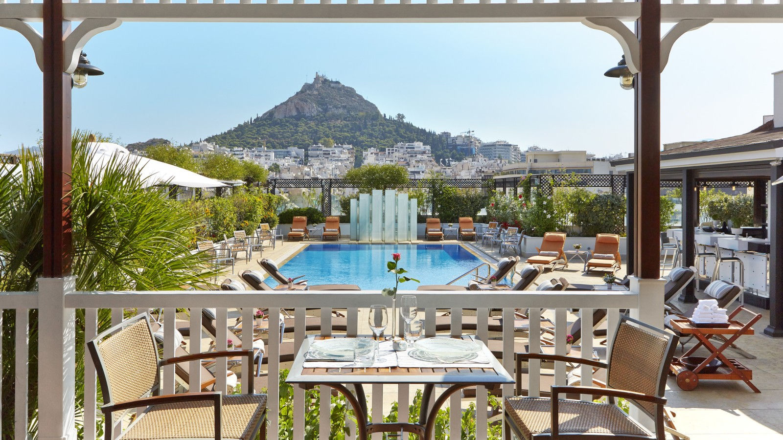 The roof-top outdoor swimming pool provides a cool respite from Athens' summer sun - Hotel Grande Bretagne, Athens