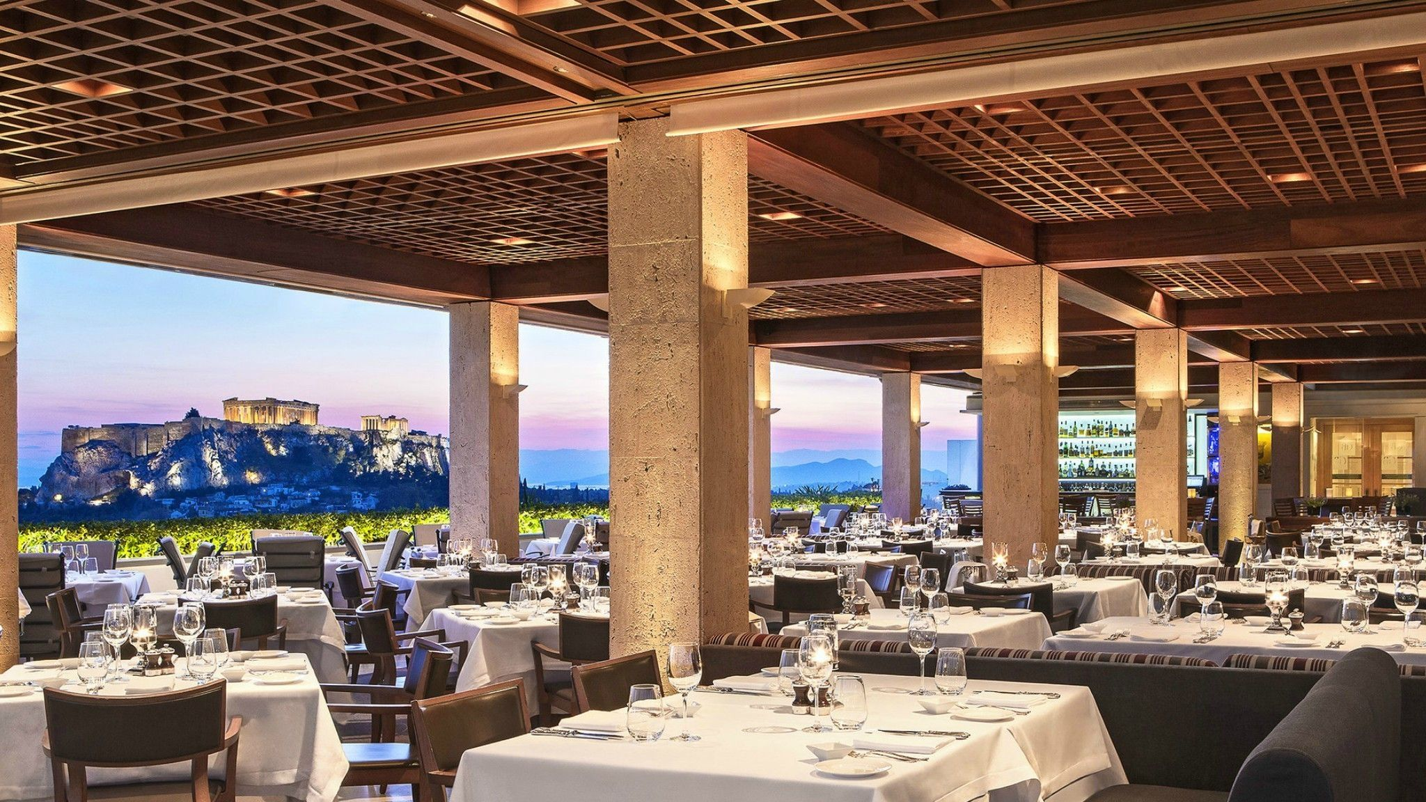 Romantic dinner at the GB Roof Garden Restaurant in the heart of Athens with amazing views to the Acropolis.