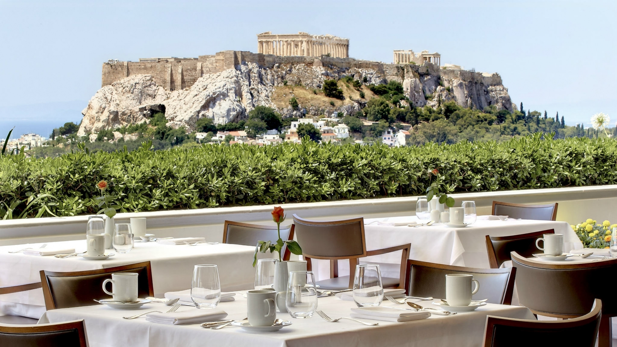 Enjoy lunch with views to the Acropolis from the roof-top GB Roof Garden Restaurant at Hotel Grande Bretagne Athens